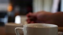 Adding sugar and milk in coffee, cafe background Stock Footage