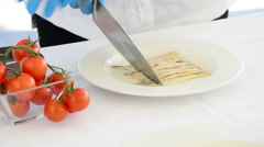 Cooking in the kitchen with a knife in a tartar of fish and tomatoes Stock Footage