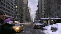 People in winter coats and warm hats crossing 5th Ave with Empire State Bldg NYC Stock Footage