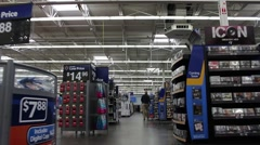 Walking down aisle shopping at superstore Stock Footage