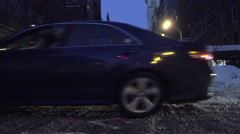 Lower 5th ave cars driving by with snow on street Empire State Building 4K NYC Stock Footage