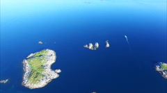 Tiny islands on norwegian coast from air Stock Footage