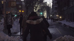 People walking near Washington Square Park arch with piles of snow street 4K NYC Stock Footage