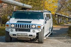 White Hummer H2 limousine at the rural street Kuvituskuvat