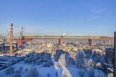 Span structures flyover being built road bridge above residential house - stock photo