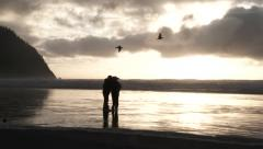 Love Birds Taking Photo At The Beach Stock Footage