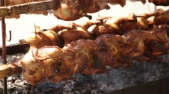 Grilled roasted chickens on a spit at Kardzhali Turkish festial - Bulgaria Stock Footage