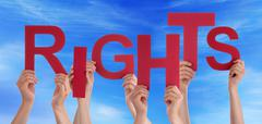 Many People Hands Holding Red Word Rights Blue Sky - stock photo