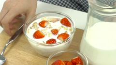 Stock Video Footage of Breakfast, pick up spoon, scoop cereal with strawberries, ready to eat, slow