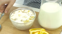 Stock Video Footage of Breakfast, pick up spoon, scoop cereal with orange, ready to eat, slow