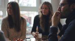 Three Friends Conversing in Bright Café - stock footage