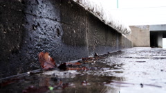 Sea pier covered with melting snow closeup  - stock footage