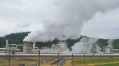 Polluting smoke and steam coming out of geothermal factory pipeline Stock Footage