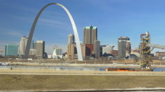 4K tracking shot of train with St. Louis Arch in background - stock footage