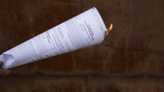 Burning paper document - stock footage