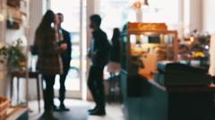Three Standing Friends Talking in Café Defocused - stock footage