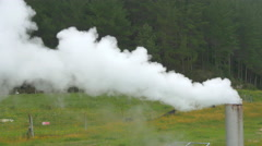 Smoke and steam coming out of geothermal power plant chimney - stock footage