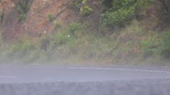 Misty steam rising from wet road surface after rain - stock footage