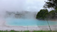Steam rising from hot water geothermal spring Stock Footage