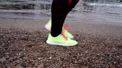 Woman sport girl walking outdoor on sea shore  Stock Footage