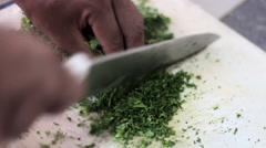 Fresh organic parsley with knife on wooden cutting board. Shallow dof. Stock Footage