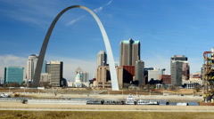 Stock Video Footage of Barge going down Mississippi River with St. Louis Arch in background