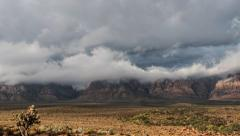 Red Rock Nevada Moving Storm Clouds Time Lapse with Zoom - stock footage