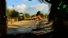 Car Wash water slowing running down front window Stock Footage