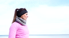 Woman resting after doing sports outdoors on cold day 4K - stock footage