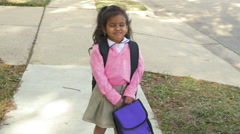 Cute little Indian girl happy about going to school slow motion Stock Footage