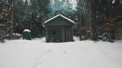 Small Rustic Cabin in the Winter. Stock Footage