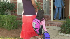 Indian mother drops preschool daughter off with babysitter or grandmother. - stock footage