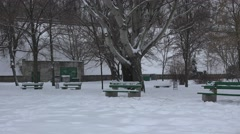 Bench unit tunes snow in the park, 4k Stock Footage