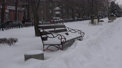 Stock Video Footage of Bench unit tunes snow in the park, the road travels urban transport, 4k