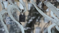 Closed lock hangs on a metal lattice - a symbol of love and friendship Stock Footage