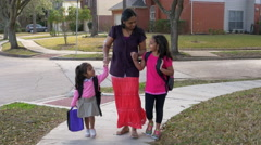 mother walking her children home from school - stock footage