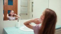 Girl went into the bath and preening. Child 7 years old standing in a bathroom Stock Footage
