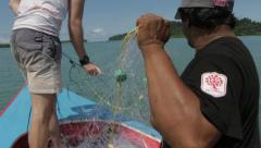 Fishermen on Longtail Boat Collecting nets Stock Footage