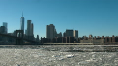 Brooklyn Bridge and Hudson River ice flow during a cold winter day Stock Footage