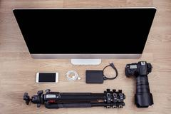 Photographer and desk scene with devices Stock Photos