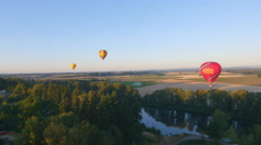 Staggered hot air balloons Stock Footage