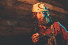 Miner Wearing Helmet Lamp and Smoking Cigarette Stock Photos