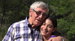 Granddaughter and Grandfather Outdoors Stock Footage