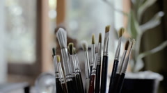 Art brushes in a cool background - stock footage