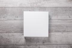 wood wall and blank paper card - stock photo