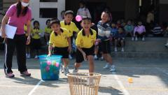 Throw the ball, kindergarten Students are studying Physical Education in School Stock Footage