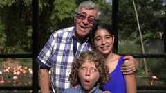 Grandfather and Grandchildren Photobomb Stock Footage
