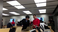 People buying iphone and paying cash inside Apple store Stock Footage