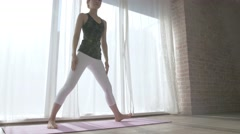Attractive Japanese young woman practicing Yoga in an airy room Stock Footage