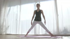 Attractive Japanese young woman practicing Yoga in an airy room - stock footage